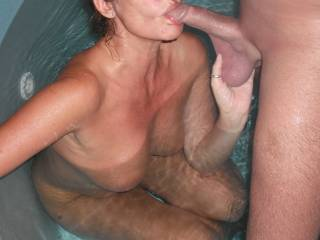 Sucking his lovely cock in our spa at home