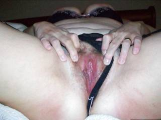 My fat hairy wife's jizz slicked pussy open for fun.