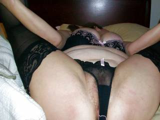 My chubby wife showing off her assets in lingerie.