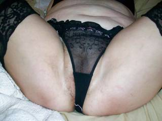 My chubby wife's hairy pussy thing to poke through her sheer panties.
