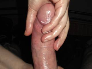 Handjob in progress. Rubbing my boyfriends big dick with warm oil.