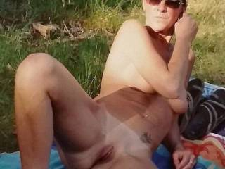 Just relaxing nude down by the riverside