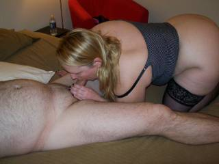Lupo's wife putting on a show for me as she sucks on her cuckold hubby Lupo.  She hardly sucks his cock, let alone acknowledges his presence when we fuck!